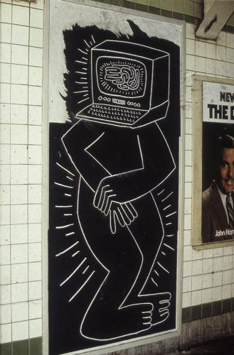 Computer-headed figure by Keith Haring