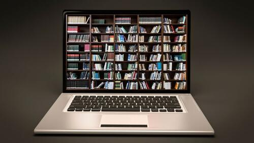 picture of a laptop that is displaying collections of books