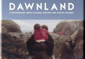 Image of front cover of Dawnland DVD with man carrying small child on his back.