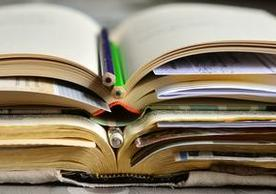 Picture of various books and pencisl